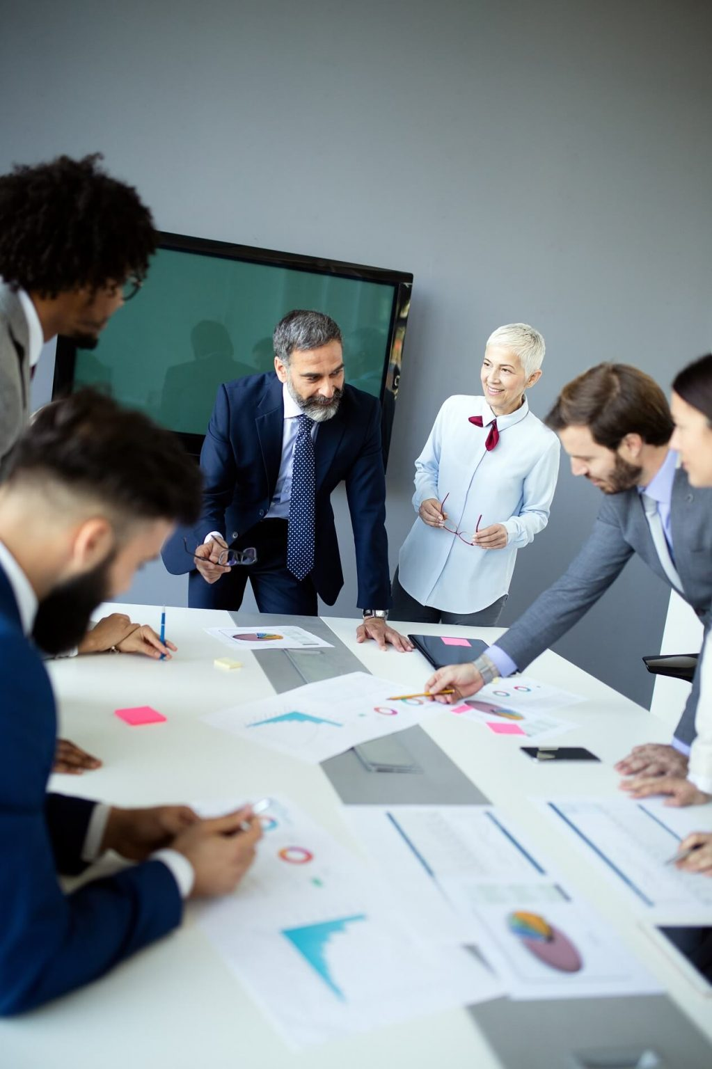 Insurance Estate plan group-of-happy-business-people-working-in-a-meeting