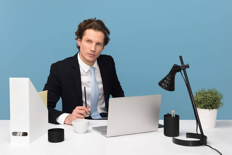 Man in Suit working on laptop needs Business protection